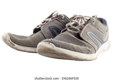 pair of worn out sneakers isolated on white background