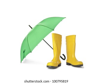 A pair of yellow rain boots and a green umbrella on a white background