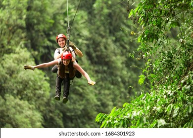 pair zipline pair of travelers in ecuadorian andes race zipline canopi sexual water timber team holiday hazard vegetation earth energetic outdoor expedition couple crowd ecuador soaring outside shower