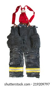 A paire of used worn firefighter pants isolated on white background
