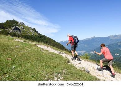 Pairolo, Switzerland - 15 July 2017:  people treking on Denti della vecchia mountain over Lugano on the italian part of Switzerland