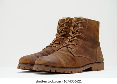Pairs of Brown suede boots is on the clean white background