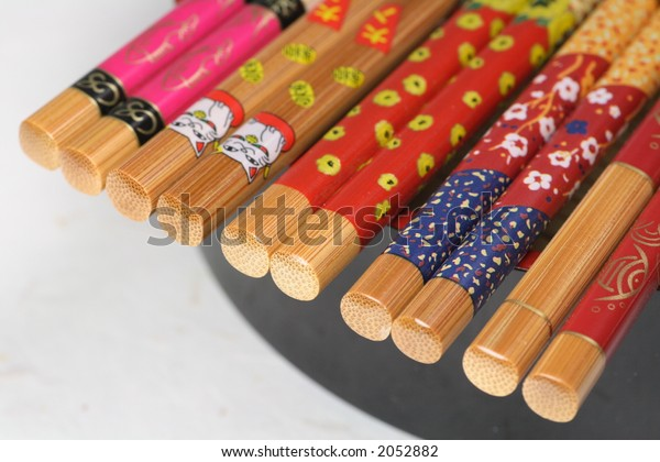 Pairs of Chopsticks with Black Plate
