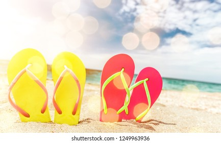 Pairs Of Flip-flops On Beach, vacation concept