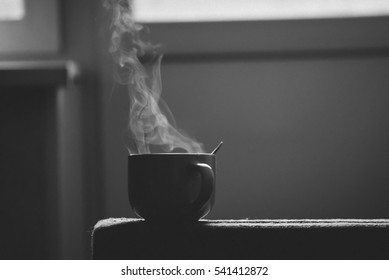 pairs of a large cup of coffee. black and white photography