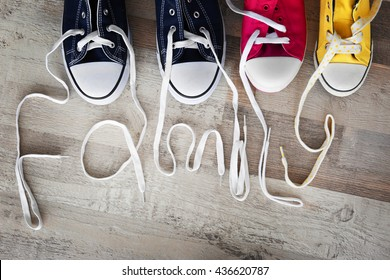 Pairs of shoes on a wooden parquet. Family concept