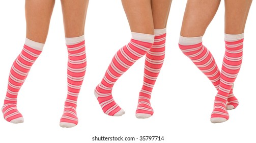 Pairs of women legs in color pink socks standing in different poses isolated on white