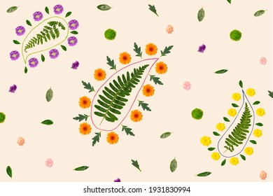 Paisley inspired floral pattern. Arrangement created from fresh colorful natural flowers, green leaves and strings. Top view against campagne background color.