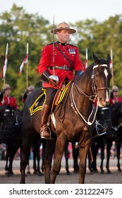 PAISLEY, ONTARIO - JUNE 6, 2012: The Musical Ride of the Royal Canadian Mounted Police. Here the commander presents the troops before the ride commences.