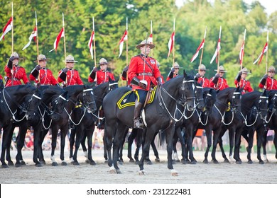 PAISLEY, ONTARIO - JUNE 6, 2012: The Musical Ride of the Royal Canadian Mounted Police is an event showcasing the equestrian skills of the thirty-two cavalry who are regular members of the force