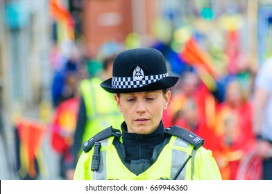 PAISLEY, SCOTLAND - JULY 1, 2017: Female officer of Police Scotland on duty during the celebrations of Sma Shot Day, parade travelling through the streets of Paisley from Brodie Park to Abbey Close