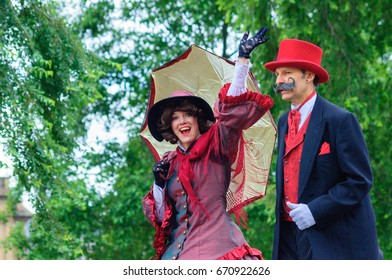 PAISLEY, SCOTLAND - JULY 1, 2017: Two of the participants celebrating Sma Shot Day in the parade travelling through the streets of Paisley from Brodie Park to Abbey Close
