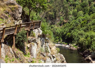 Paiva's walkways. Wooden walkways at Paiva river, in Portugal, that runs right over the river, side by side. Pedestrian walkway, overlooking the Paiva river.
