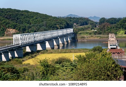 PAJU, SOUTH KOREA- SEPTEMBER 28, 2017: New bridge and old bridge ruined in the korean war, crossing a river in direction of the North Korea and South Korea DMZ in the Summer
