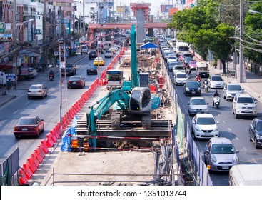 PAK KRET, NONTHABURI, THAILAND - MARCH 14, 2019 : Back Hoe working at construction site of monorail MRT Pink Line (Khae Rai-Min Buri) at Tiwanon Road. Foundation and groundwork.