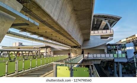 The Pak Nam BTS Sky Train Station in the evening has an overpass connecting from the station to the inbound Sukhumvit road below the BTS station, taken on December 13, 2018 in Samut Prakan, Thailand.