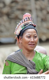 Pak Nam Noy area, Laos-October 8, 2015: The Akha Pala tribe are an ethnic minority living in the area between E.Myanmar-N.Thailand-W.Laos-S.China. Bracelet selling woman showing traditional headdress.
