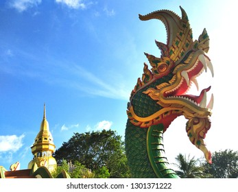 Pak Phayun Temple Phatthalung has a green color, two serpents along the corridor, made of cement.