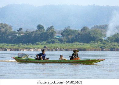 Pakbeng, Laos - January 25, 2017: Local people riding speed boat on the Mekong river in Laos