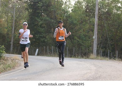 PAKCHONG, THAILAND - JAN 31 : Unidentified trail runner running in The North Face 100 event on January 31, 2015 in Nakhorn Ratchasima, Thailand.