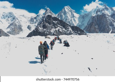 PAKISTAN - 3rd August 2017 : A group of hikers from Malaysia walking on ice in their journey to conquer K2 Basecamp in Skardu Pakistan