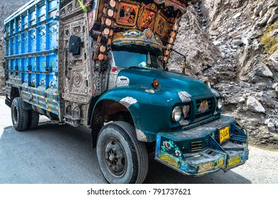 pakistan april 2016 a lorry full load of goods pass the bad surface rood at karakoram highway pakistan.