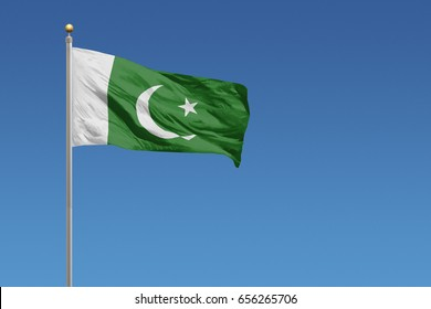 Pakistan flag in front of a clear blue sky