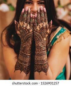 Pakistan Indian bride showing hand mehndi design Islamabad, Pakistan, 01, October, 2019