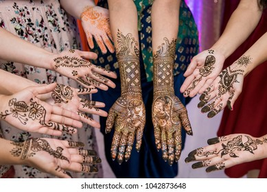 Pakistan Indian brides & bridesmaid showing Jewelry Bangles, Rings & henna design and colorful wedding dress