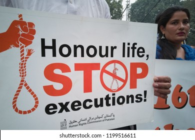 Pakistan- Lahore, Activists hold a banner as they shout slogans on the day of world day against the Death Penalty on October 10, 2018.