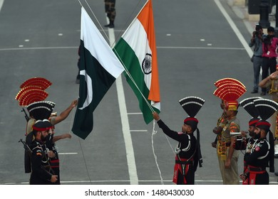 Pakistan Rangers (wearing black uniforms) perform during a parade on the Pakistan's 72nd Independence Day at the Pakistan-India joint check post at Wagah border, near Lahore, Pakistan, August 14, 2019
