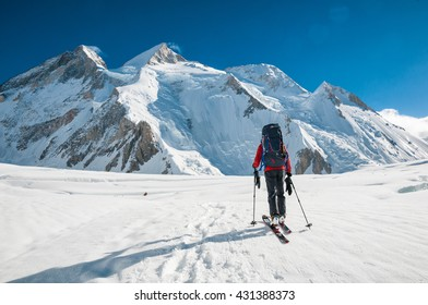 Pakistan, South Gasherbrum Glacier, July 2015 - Skier on the glacier, heading to Gasherbrum's Camp I, Gasherbrum II in the background