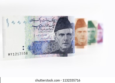 Pakistani currency bank note of 1000 rupees isolated on white background.