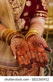 Pakistani Indian bridal showing henna design and hand jewellery