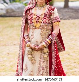 Pakistani Indian Bridal showing wedding dress and jewlery