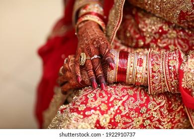 Pakistani Indian bridal showing wedding rings and bracelet jewelry