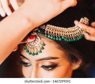 Pakistani Indian bridal wearing matha patti jewelry Islamabad, Pakistan, 15 July 2019