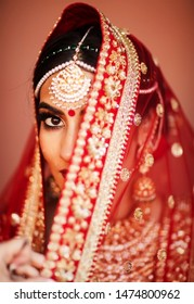 Pakistani Indian bridal wearing veils ghoonghat her wedding day Islamabad, Pakistan, 15 July, 2019