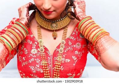 Pakistani Indian Bridal wearing wedding choker necklace and showing other jewelry Islamabad, Pakistan, July 31, 2019