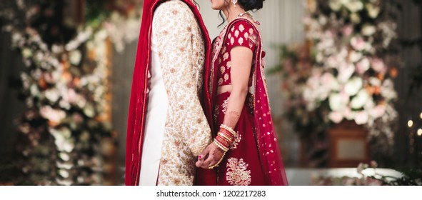 Pakistani Indian Bride holding hands for wedding day style