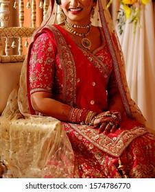 Pakistani Indian bride on her red lehenga with her ceremony jewelry Karachi, Pakistan, November 01, 2019