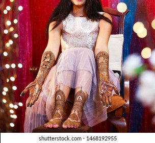 Pakistani Indian bride showing mehndi design hands and foot