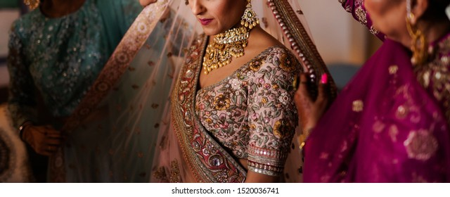 Pakistani Indian bride wearing ghoonghat and showing wedding jewelry Islamabad, Pakistan, 31, August, 2019