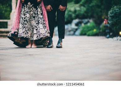Pakistani Indian couple showing their footwear
