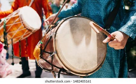 Pakistani Indian dhol player playing groom wedding baraat