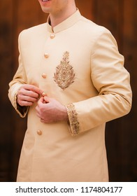 Pakistani Indian groom getting ready wedding sharwani dress