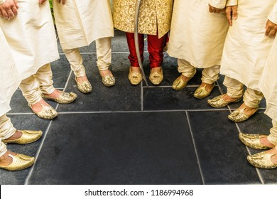 Pakistani Indian Groom with groomsman showing wedding Khussa Shoes and  dress