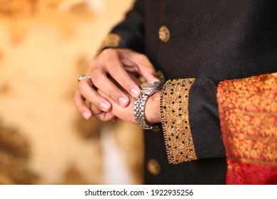 Pakistani Indian groom showing wedding hand watch