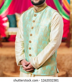 Pakistani Indian groom wearing sangeet shalwar kameez his wedding day