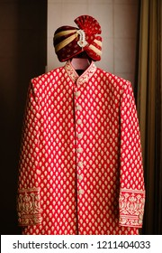 Pakistani Indian groom's red sherwani and wedding turba